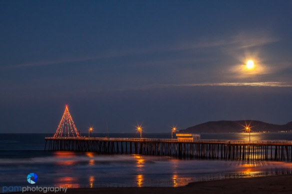Moonset over pier