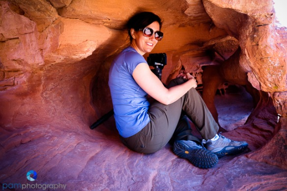 "Mary in the ""small cave"" making a photo of the arch"