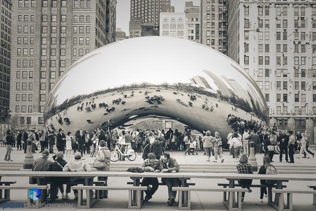 Tourists planning their day at the Bean in Chicago's Millennium Park