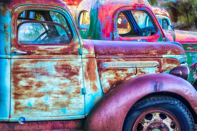 There are a lot of old cars and trucks