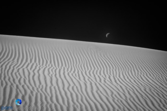 Moon set over dune